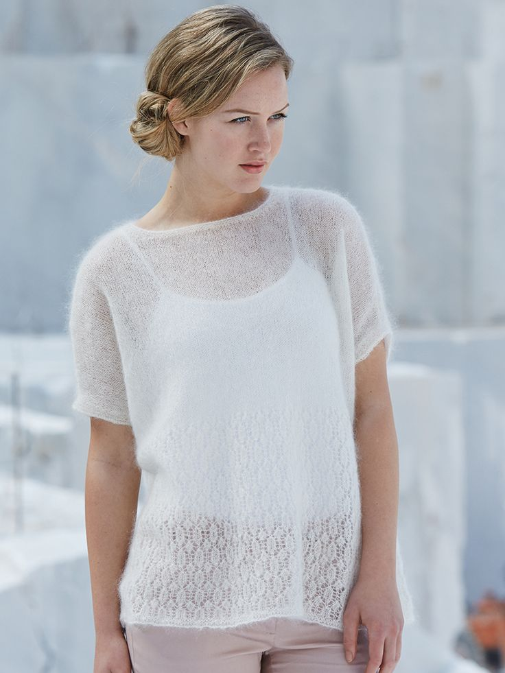 Foxglove - Knit this women's lace panel relaxed fit top from the Simple Shapes Kidsilk Haze Collection, a design by Marie Wallin using the stunning yarn Kidsilk Haze (mohair and silk). The top half of the garment is in stocking stitch with the bottom half worked in a beautiful lace pattern, with wide round neck and short sleeves, this knitting pattern has a three star difficulty rating.