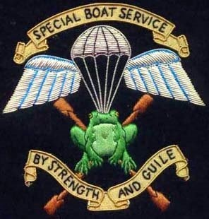 """The emblem of the SBS, Special Boat Service, shown here has the new motto, """"By strength and guile."""" The old motto was, """"Not by strength by guile."""" The old one is more sinister! Sgt Casey in The Witness is sinister. Don't mess with him!"""