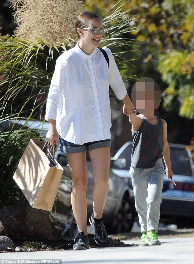 Happy families: Pregnant Natalie Portman was seen taking a stroll with her cute son Aleph on Saturday in Los Angeles