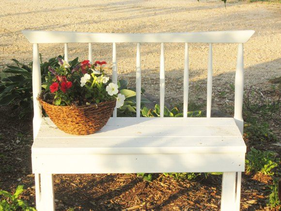 We have 9 garden beds in our yard.  Our goal was to put a structure piece in each garden.  I thought it would be fun to try our hand at a headboard bench I had…