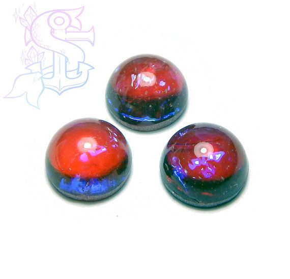 This magical stone looks deep crystal red, but with more attention youll see vanishing and flashing blue streaks! They can be used for different purposes as fine handmade jewelry setting them on cameo settings, ring settings, little frames, they are suitable for many others craft project as well!  Please allow a minimum color differences due to different monitor settings from mine to yours!  (¯`·.¸¸.-> °º Cabochon measurements: ø10mm º° <-.¸¸.·´¯) You will receive 1 cab with this listing…