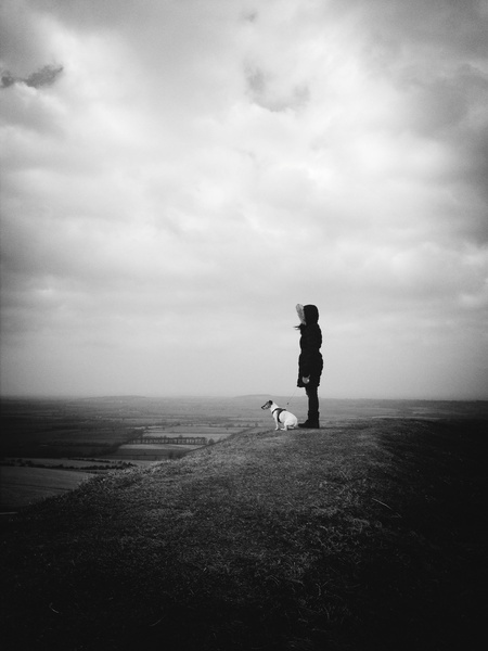 Women and Jack Russell dog on a hill Art Print