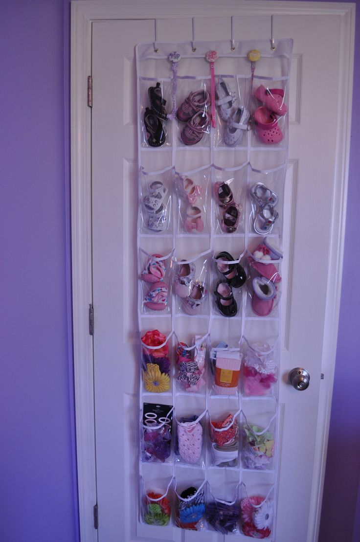 Great way to organize baby shoes, headbands, and accessories.  Clear plastic over the door shoe organizer.