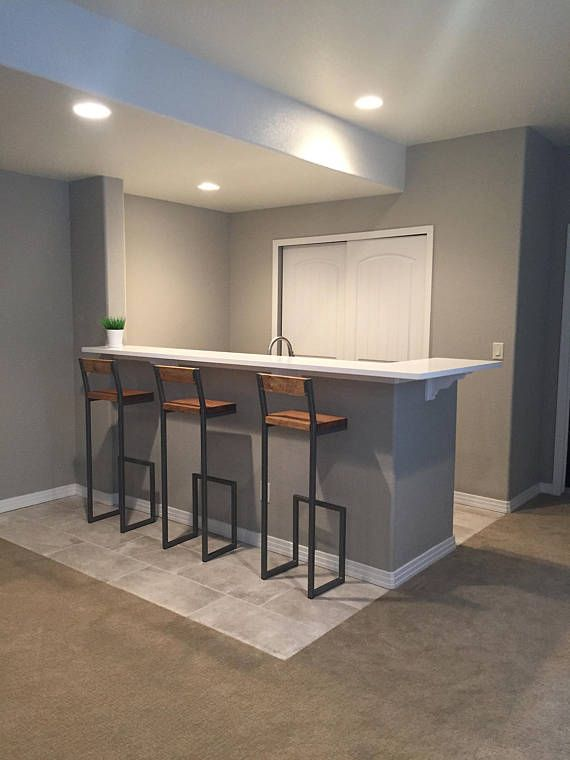 Custom Bar Stool. 30 tall, Floating style with back, Hammered black frame color, Dark brown Minwax dark walnut stained seat.