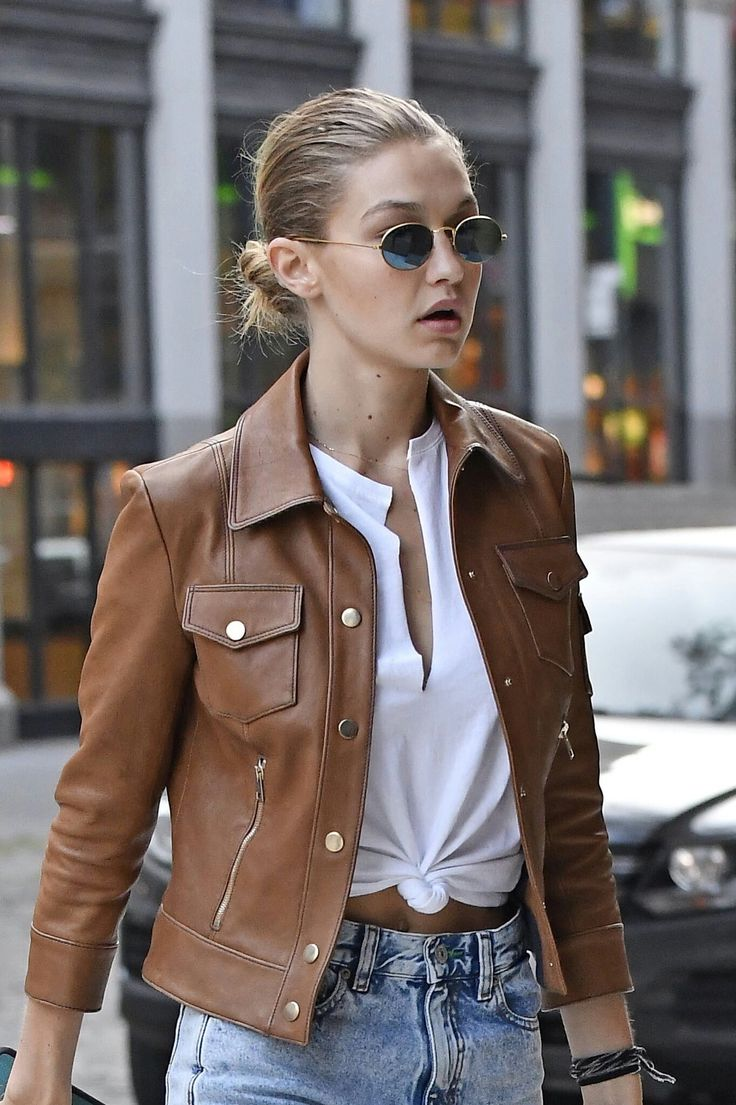 #GigiHadid look like a rockstar in her tan leather jacket and cropped top!  #falloutfits #celebstyle