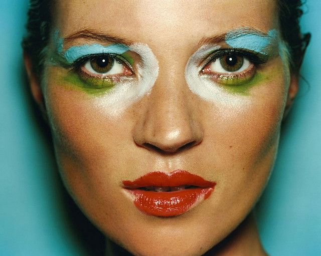 "Kate Moss by Mario Testino, 2001 -------  This specific photograph is similar in ways to the other images with the red lips on the model and the warmer lighting this model has been made to look as if a child has done her make up as it is not perfect, which works with the issue because in a stereo typical way all ""perfect"" women are seen as skinny, no shape and great make up , so the photographer has changed the way we as a population see women in this generation and that no one is perfect."