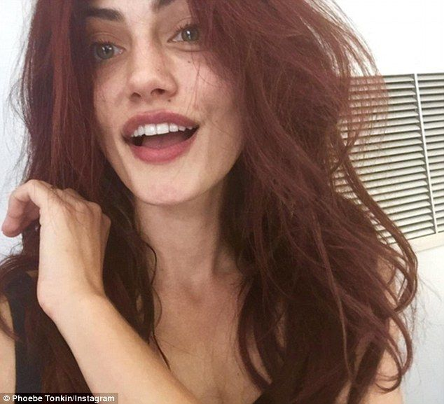 Fiery new look: Phoebe Tonkin shared a selfie of herself on Instagram to her 1.7 million followers, sporting some newly died mahogany locks