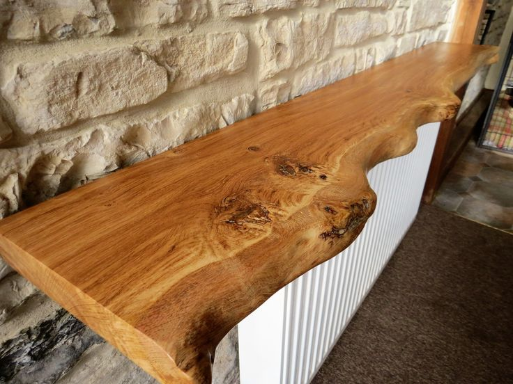 Live Edge English Burr Oak Air Dried Floating Shelves. Hand crafted from an Oak burr board, shaped then sanded down from 60 grit to 240 grit, coated with 3 layers of Briwax.  This bespoke rustic oak timber shelf measures, L=150cm x W=21cm x W= 26cm widest point Thickness 40mm  I am hoping to start a small business from home producing bespoke shelves, small beams and mantles after being made redundant. All of the timber used for creating these wood products are sourced from reclamation yards.