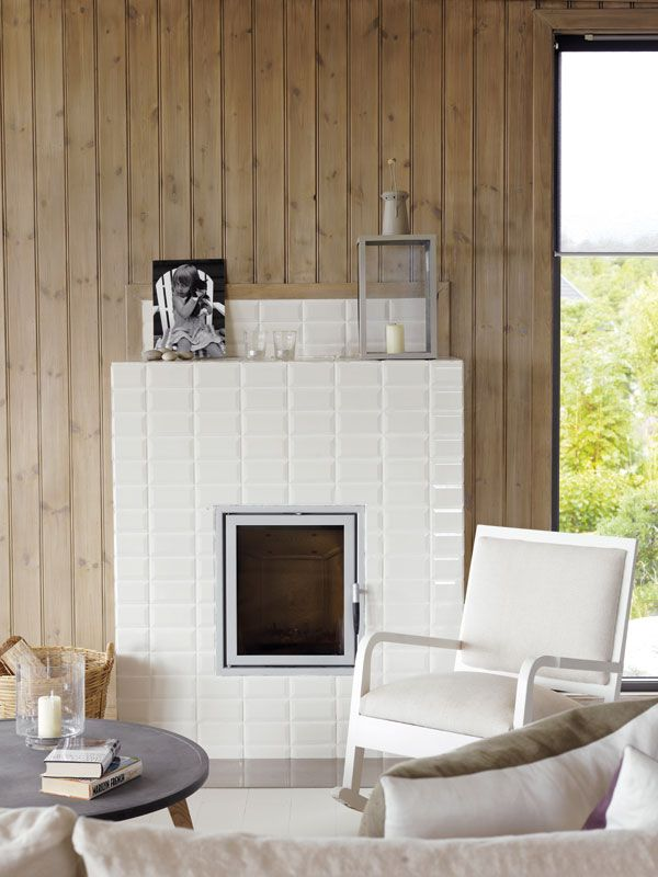 Love this white fireplace next to the greyish wood