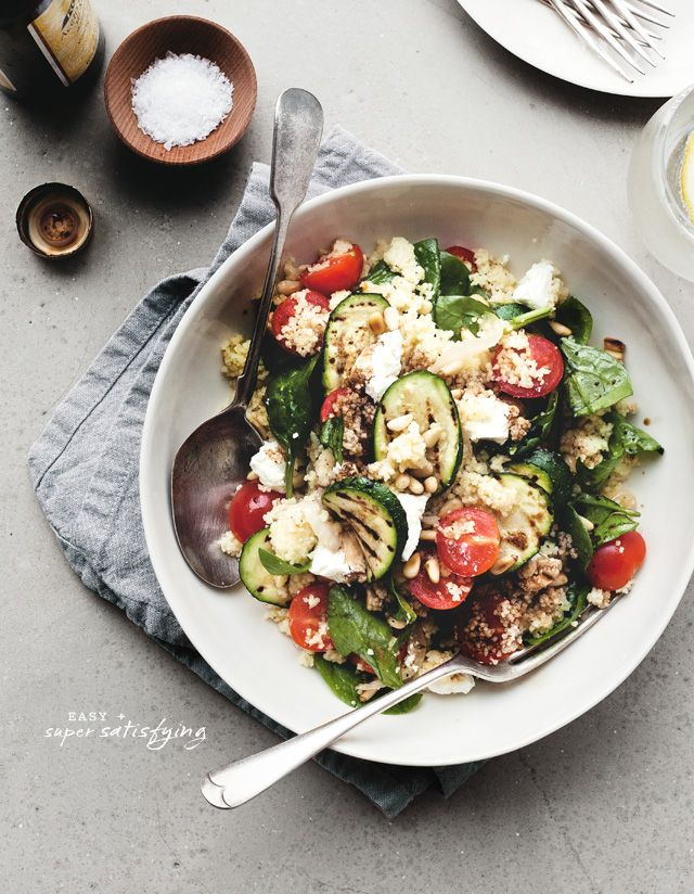 Warm couscous salad with grilled zucchini, cherry tomatoes, spinach, toasted pine nuts, feta/goat cheese, lemon juice  balsamic drizzle.  (Chantelle Grady)