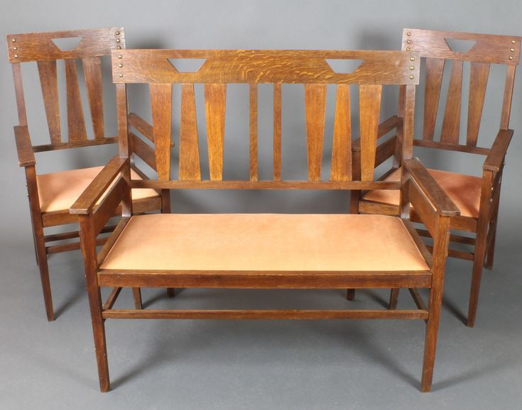 LOT 904, An Art Nouveau oak double chair back settee, raised on square tapering supports together 2 matching armchairs SOLD £360