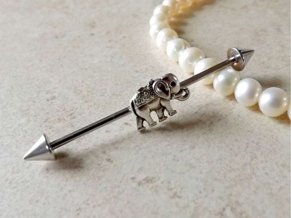FREE SHIPPING ON ALL ADDITIONAL ITEMS! Industrial Barbell with elephant charm. The elephant is approx 10mm x 10mm This industrial barbell is