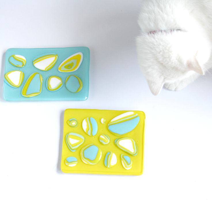 Fused glass little plates. With Squish the cat. Melted by Suzanne