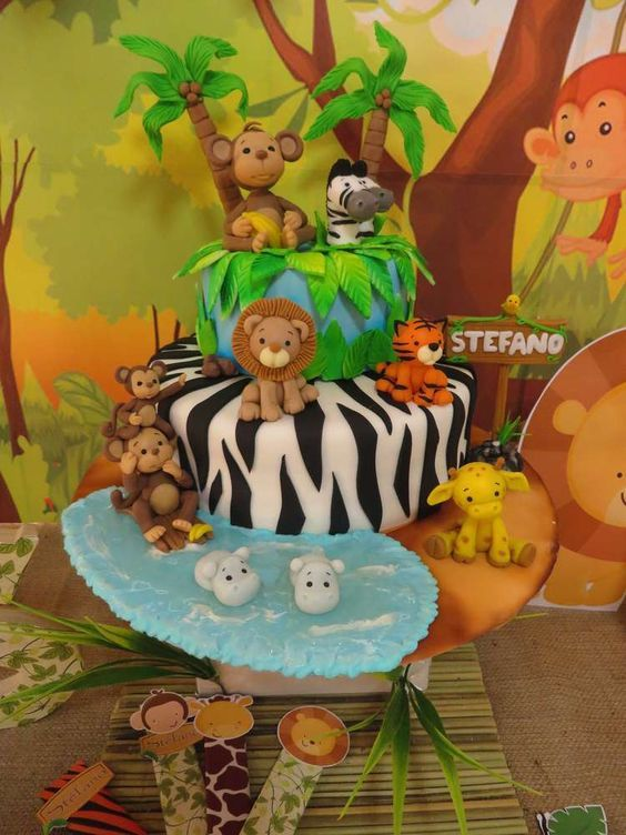 Amazingly cute cake at a jungle baptism party! See more party ideas at CatchMyParty.com!