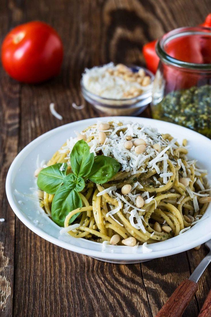 Spaghetti with basil pesto sauce, pesto pasta with pine nuts and basil, Italian