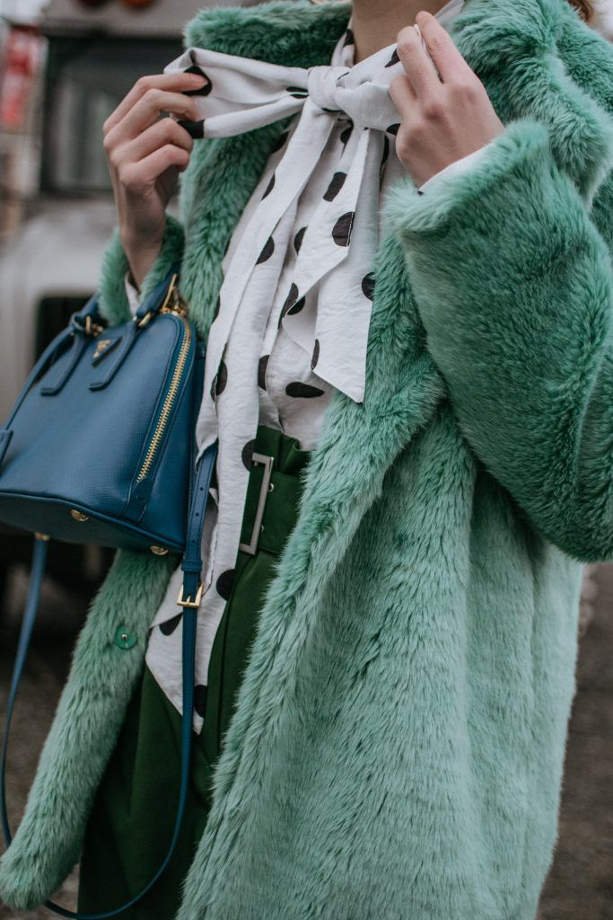Mint faux fur coat,green teddy bear coat,high waisted green trousers, emerald pants, polka dot pussy bow blouse, jacquemus budget friendly polka dot tie neck blouse, polka dot shirt, baker boy cap, news boy hat, the cap and hat you see all over instagram, prada cobalt blue saffiano lux borsa a mano bag, mini blue prada bag, black heeled balenciaga lookalike sock boots, andreea birsan, couturezilla, cute fall outfit ideas 2017, casual outfit ideas for winter 2017, what to wear to work and…