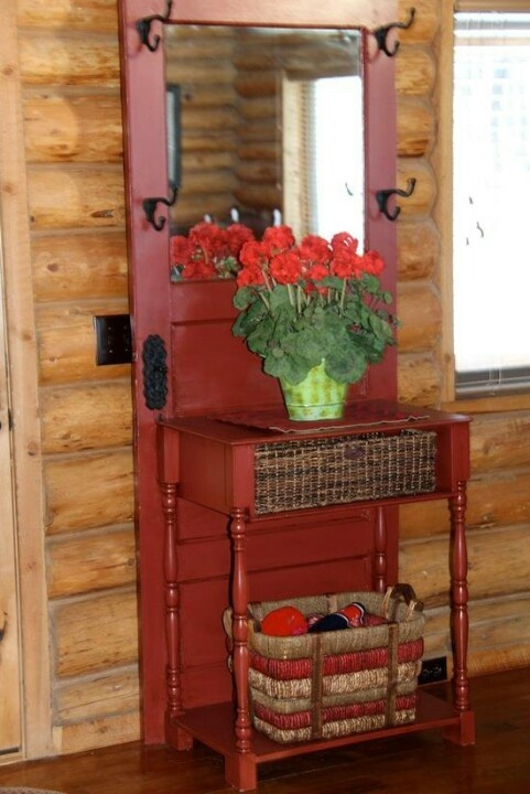Hall tree... old door,  hooks and baskets!  Love it!