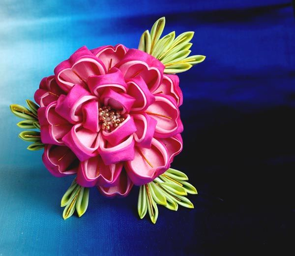 Peony    It's been a while since I made any kanzashi but i recently started up on my project to make one of every monthly maiko kanzashi. This one is peony for March