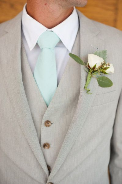Grey is a refreshing and relaxed colour that is very popular this season! This grey suit pairs well with light, pastels that can be reflected in the tie or buttonhole. ~ E.A