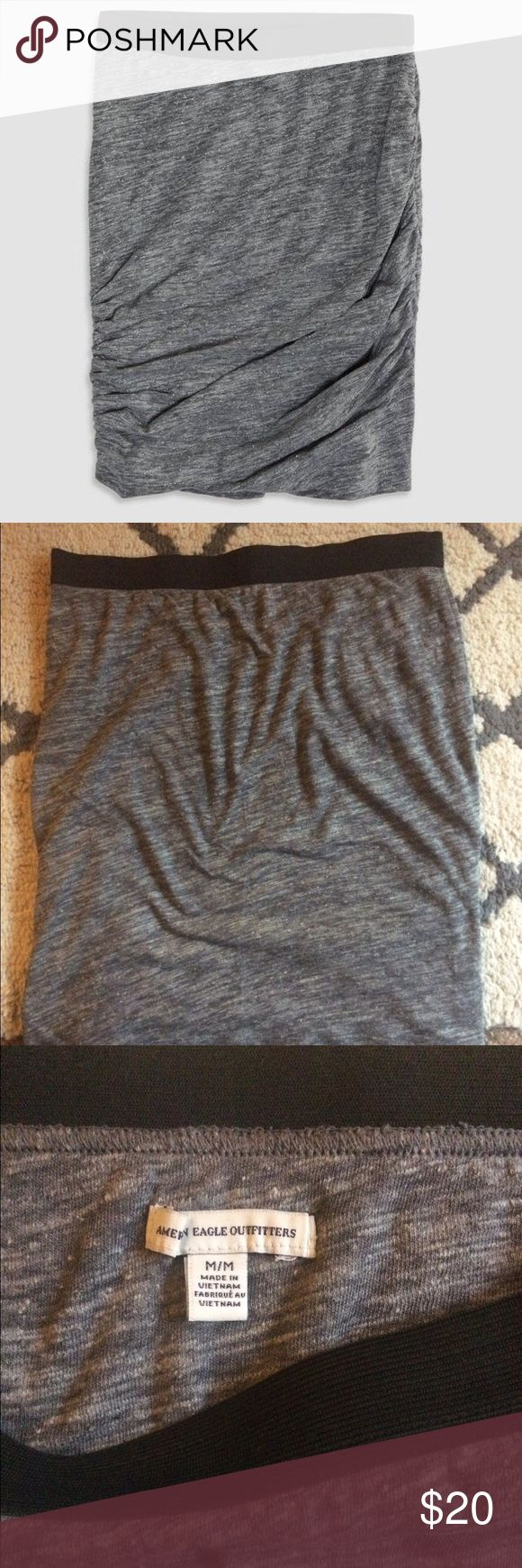 """AE shirred tube skirt Very cute and comfy shirred tube skirt. Similar to the very popular T by Alexander wang skirt. Very stretchy grey fabric with a black elastic waistband. Stretchy but doesn't stretch out after wearing. Fits small, like a fitted S or regular XS. Some pilling throughout (see pic). I'm 5'4"""" and it hits me at the knees. No trades. American Eagle Outfitters Skirts"""