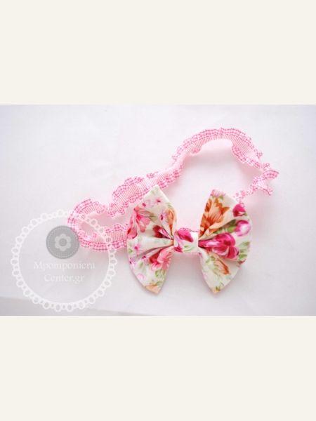 Φιογκάκι φλοράλ σε φούξια-ροζ , λαστιχένια στέκα ιδανική για μωρά.
