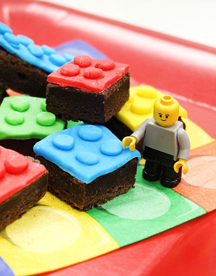 LEGO Brownies are the perfect addition to any LEGO birthday party! Simply cover each brownie in coloured icing for an easy LEGO party food idea. Visit the Party Delights blog for even more LEGO party ideas.