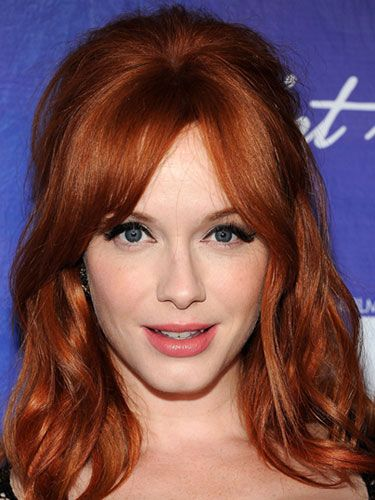 Christina Hendricks Bangs - Another va-va-vroom thing about the Mad Men actress: her gently teased style and face-elongating bangs.