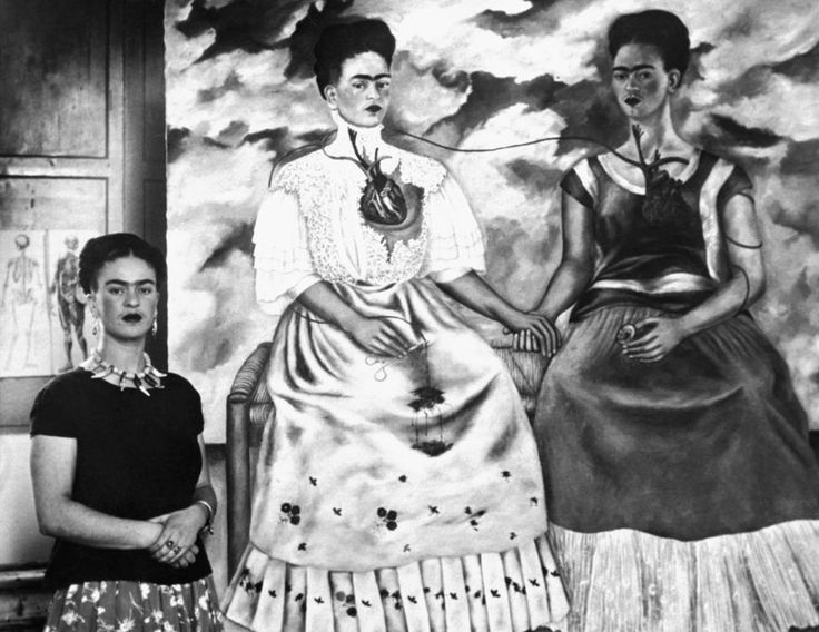 ~ Frida Kahlo: Many of Frida Kahlo's self-portraits are expressions of the duality she felt at having both European and Mexican heritage, as shown in this 1939 painting entitled 'The Two Fridas'. (Photo: Bettmann/CORBIS):