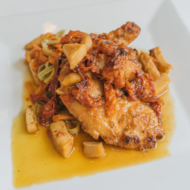 Criollo's Pan Roasted Airline Chicken is savory, sun-dried deliciousness on a plate.