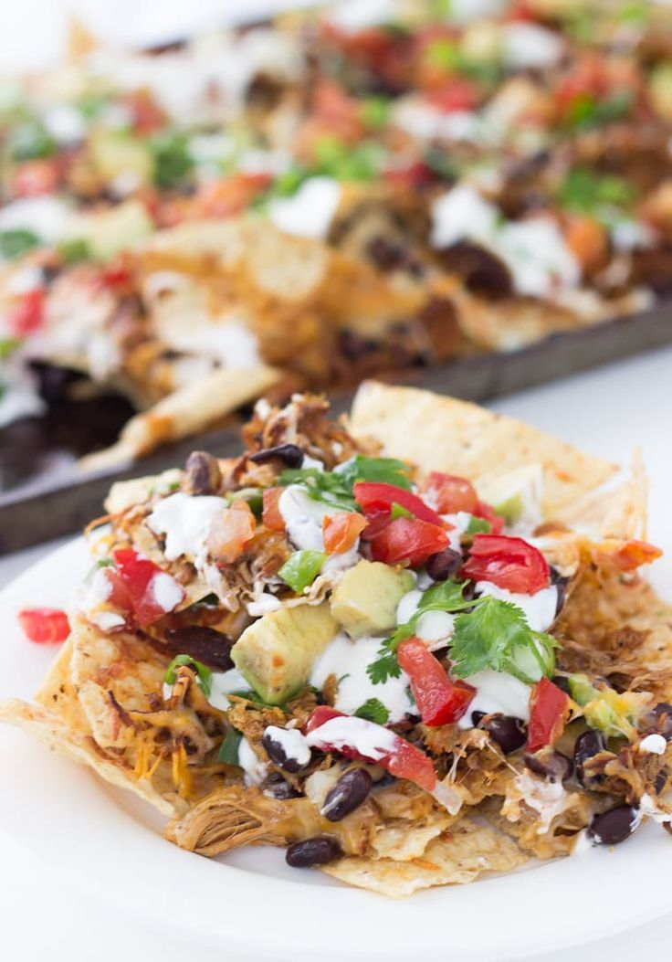 This nachos recipes of Shredded BBQ Chicken Nachos is easy and simple to pull together for any occasion.
