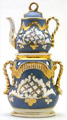 A beautiful antique porcelain Veilleuse-Theieres, or 'night-light' teapot.  Items like this one were used to hold a candle - they acted as both a nightlight and a tea warmer. The legend is that Napoleon didn't like to sleep in the dark and started using them in his tent, so they became popular. This example is in the Trenton Teapot Collection which has the world's largest collection of these interesting vessels, over 500  dating from 1750-1860.