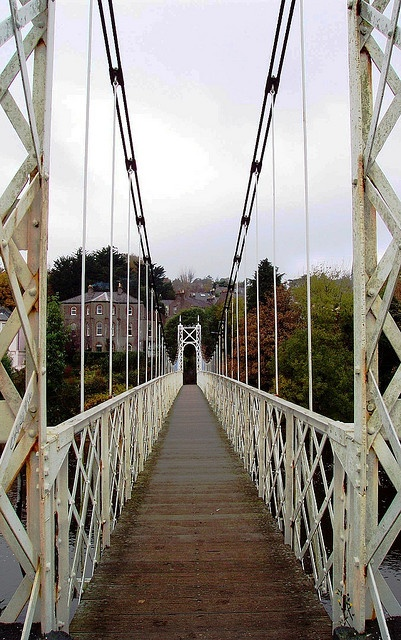 Daly's Bridge, locally known as Shakey Bridge, Cork City, Ireland.  The pedestrian bridge spans River Lee, is 4 1/2 ft wide, and shakes when people jump or run across.