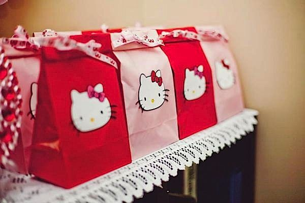 Hello Kitty birthday favor bags...red and pink and red lunch sack bags(Walmart or Hobby Lobby), HK ribbon and cut-out printable HK faces