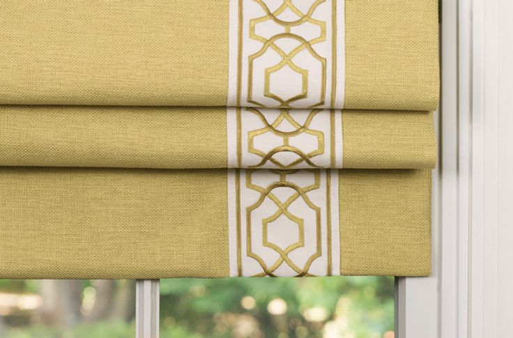 Gold yellow roman blind shade with contrast embroidered braid. Keiro by Samuel and Sons Passementerie
