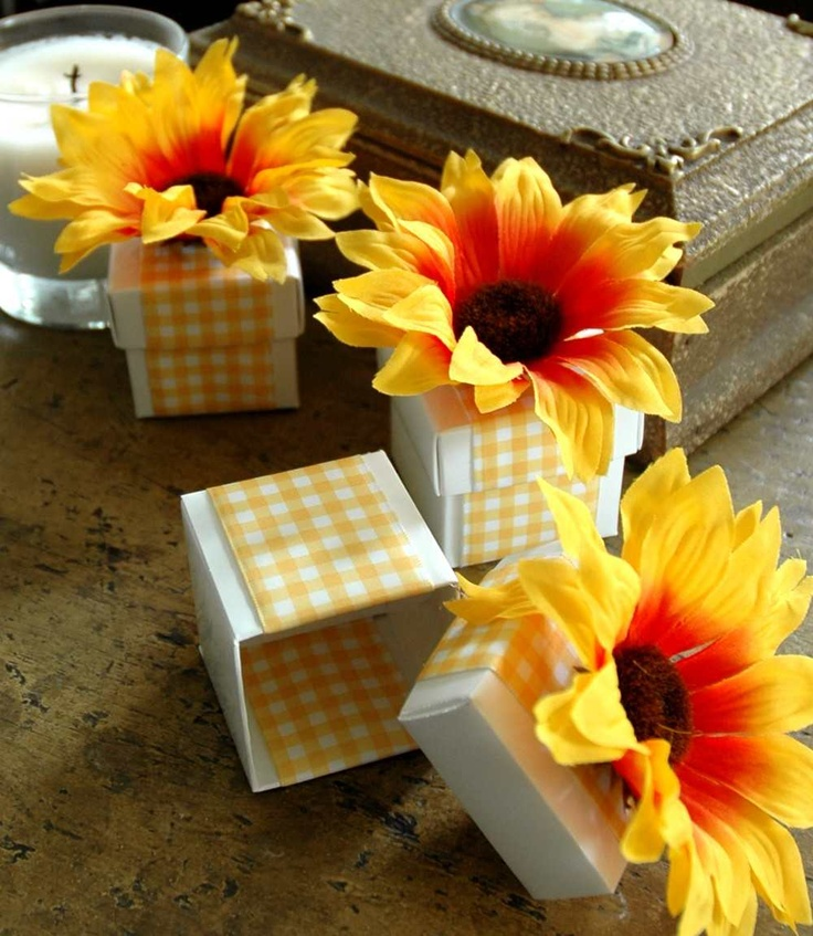 Becki, Lots of sunflower ideas on this site. Also saw small paperbags with sunflower design stamped on it on another site.