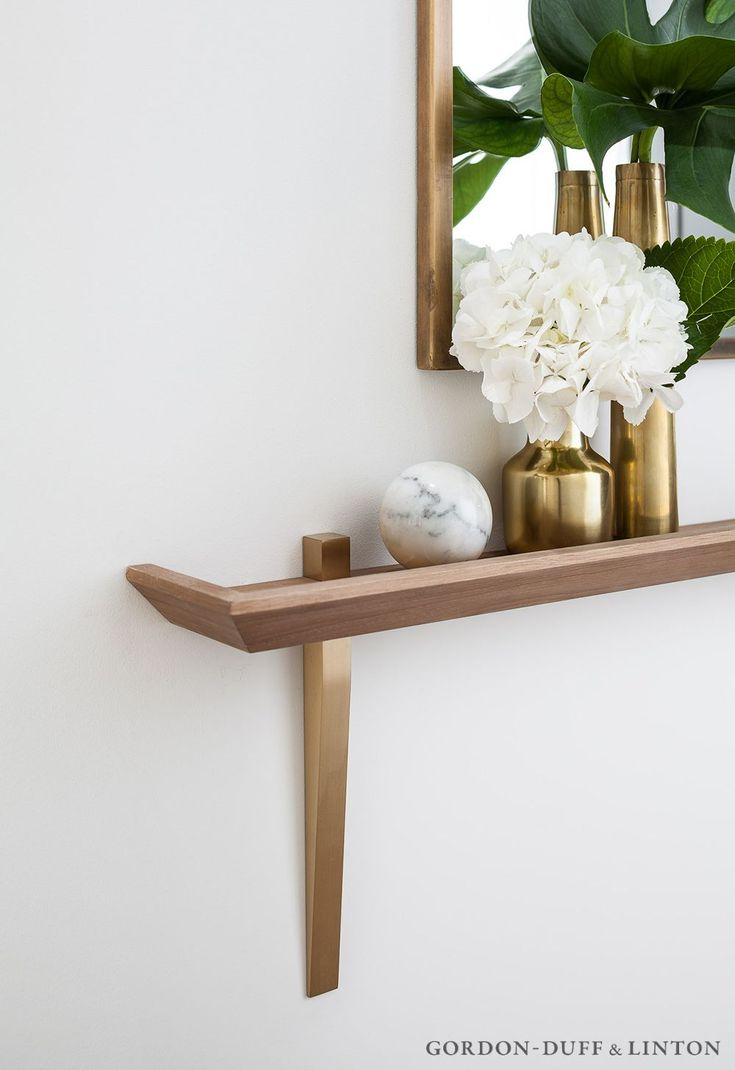 Hallway featuring our trade mark shelf with solid brass supports - designed by Gordon-Duff & Linton with a brass framed mirror above. #GD&LBespokeFurniture