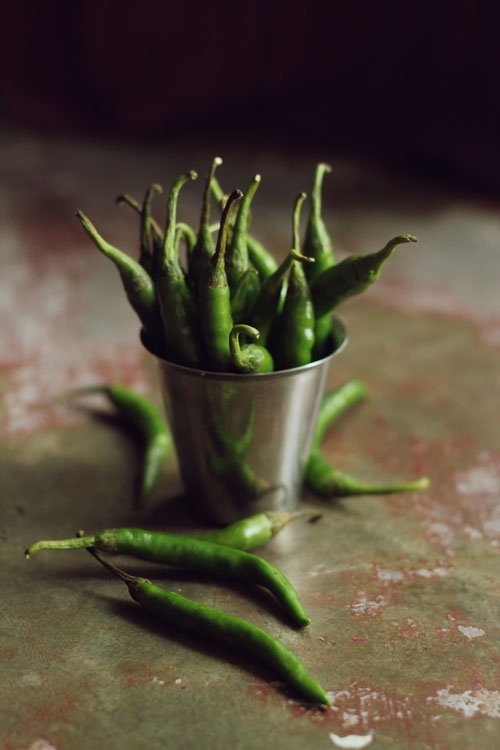 Green chilies are rich in vitamins A and C with the dried version higher in vitamin A and the fresh version higher in vitamin C. They can contain as much as six times the amount of vitamin C as a single orange.