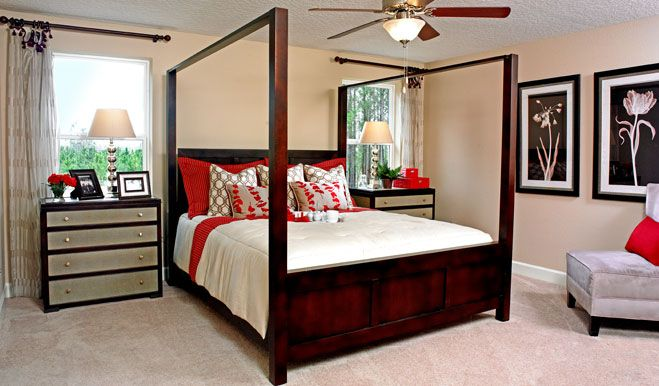 A bold bed frame and matching nightstands complement the symmetry of the Seth model's master bedroom in FL. [photo 12]