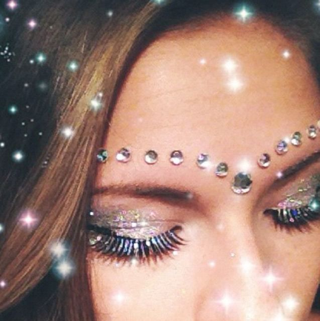 Buy adhesive rhinestones from craft stores and apply them as glittery details to your face! One drop of eyelash glue makes them last all night #WhiteWonderland