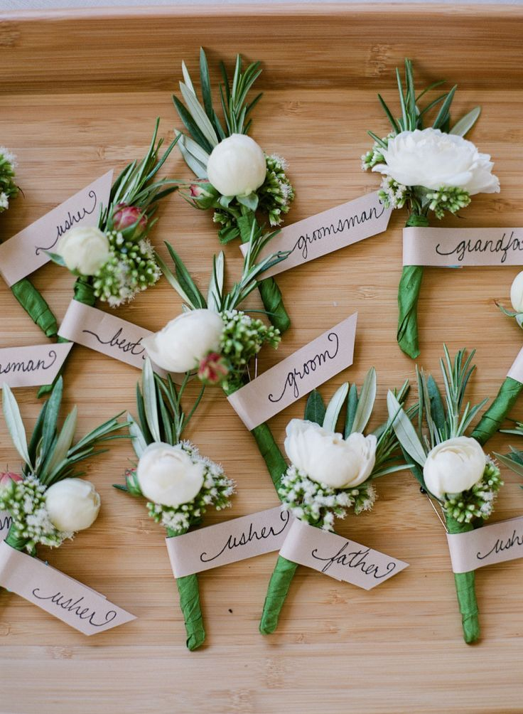 great idea for a spring wedding - boutonnieres made with rosemary and white and fuchsia flowers