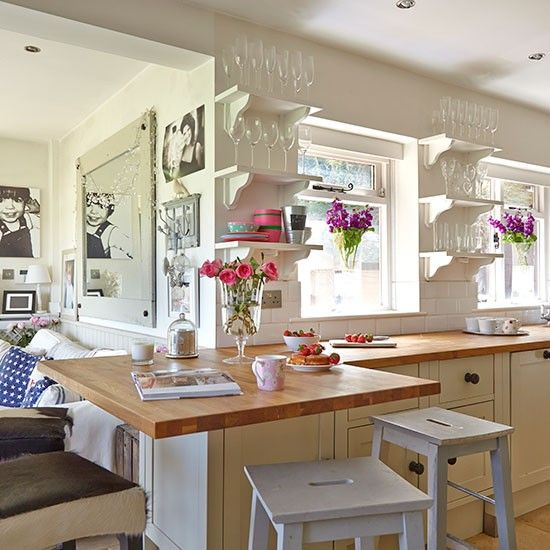 I do believe this could be kitchen heaven! Quirky painted bracket shelves; worktop-cum-table; school-style painted stools; family photo gallery; fresh flowers. What's not to love?