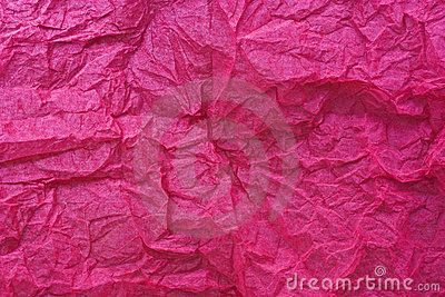 A background of   pink creased tissue paper