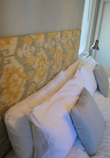 Cheap and easy DIY headboard.  This is so simple and the fabric can be changed without spending $$$$$$