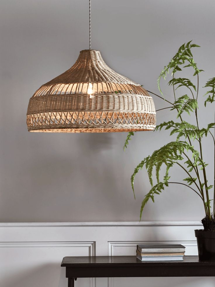 Intricately woven from natural rattan, our unique, parasol-shaped lightshade is inspired by Scandinavian style and will cast beautiful patterns across your room. Perfect for your lounge or dining room, this shade can be fitted to any pendant light fitting.