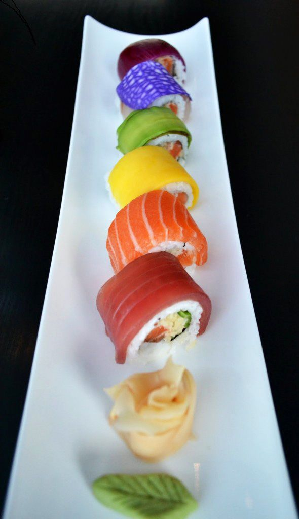 Really Rainbow Sushi. I see tuna, sake, possibly tamago for the yellow, but could also be mango (ooh, that would be good!). I couldn't figure out the purple, maybe taro? And the last one could be some kind of fish or red onion. Please comment if you know.
