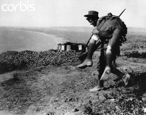 An Australian bringing in a wounded comrade to hospital. Dardanelles Campaign, ca. 1915. | Location: Gallipoli Penninsula, Turkey.