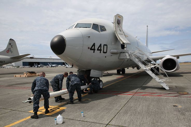 https://flic.kr/p/JiupBC   160622-N-DC740-007   HARBOR, Wash. (June 22, 2016) Sailors from Patrol Squadron (VP) 30 attach a tow bar to a P-8 Poseidon preparing to move it into Patrol and Reconnaissance Wing 10's newly renovated hangar six on Naval Air Station Whidbey Island's Ault Field for the first time. The P-8 is scheduled to replace the P-3, in naval service since the 1960s, no later than 2020.  (U.S. Navy photo by Mass Communication Specialist 2nd Class John Hetherington/Released)