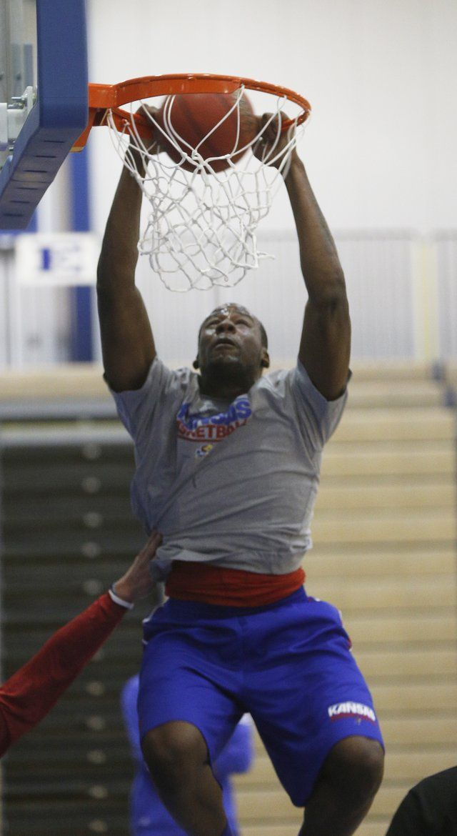 Kansas freshman big man Cliff Alexander shows campers his power with a two-handed slam on Tuesday at Bill Self's camp. #KU