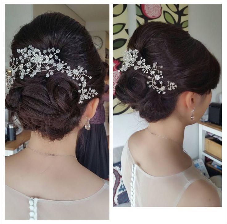 Elegant wedding updo with hair accessory.