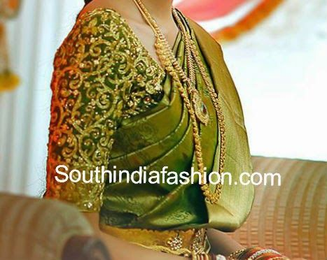 Beautiful green bridal saree blouse with elbow length sleeves and embellished with shimmering gold work all over the blouse. Related PostsGold Kanjeevaram Saree and Designer BlouseBridal Saree BlouseElbow Length Sleeves Blouse for Bridal Silk SareesWedding Saree Blouse Designs